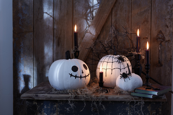 9 handmade-halloween-pumpkins-white-paint-black-glitter-powder